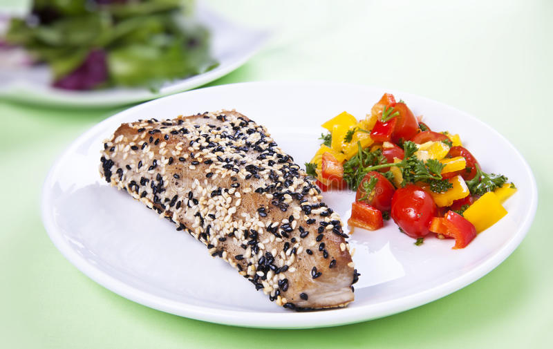 Tuna steak. Yellow-fin tuna steak with sesame seeds and vegetables - horizontal stock photos