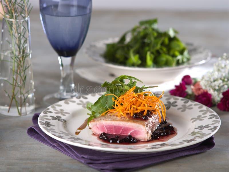 Tuna steak in blackberry sauce royalty free stock image