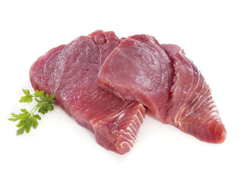 Tuna steak. In front of white background stock photo