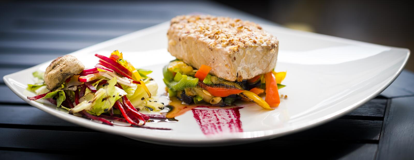 Tuna steak. In sesame crust withvegetables royalty free stock photos