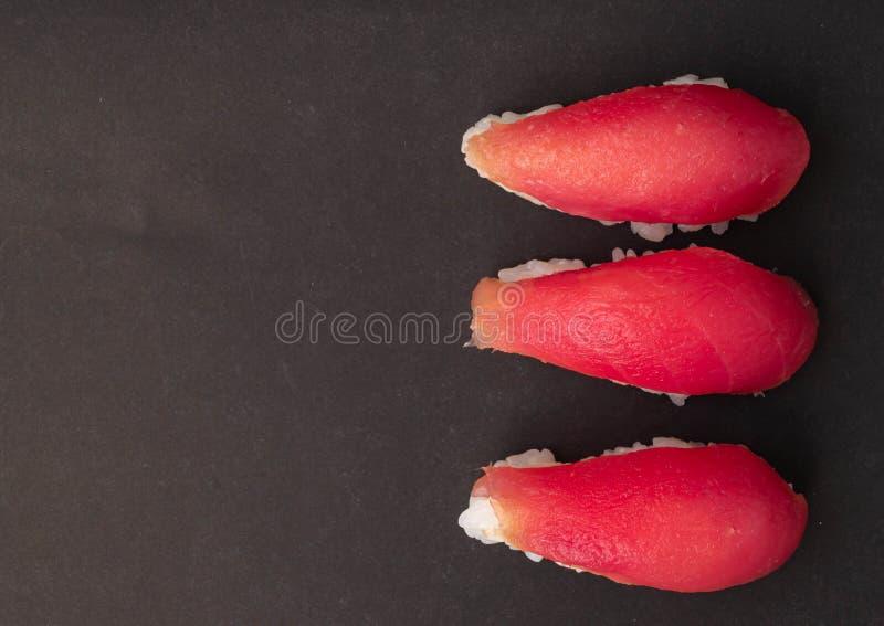 Tuna sushi on black background stock photo