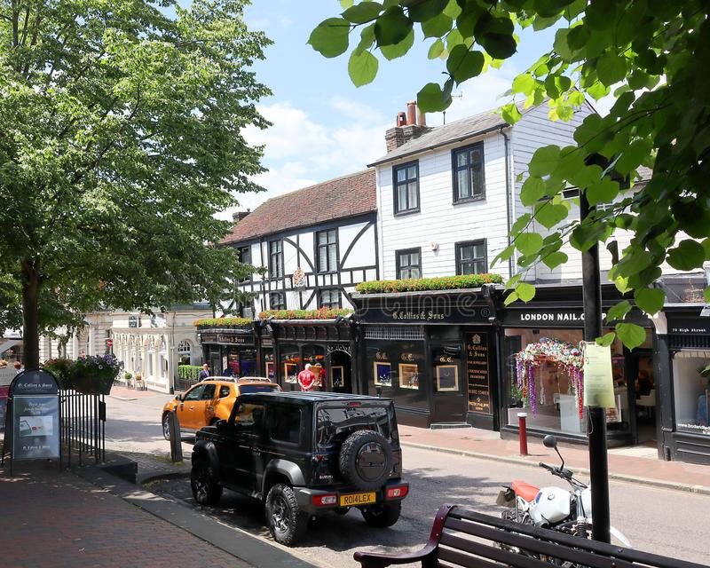 Tunbridge Wells street with smart shop fronts. An interesting road in Tunbridge Wells with lovely old buildings  on a sunny day royalty free stock photos