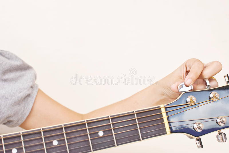 Tune up classic acoustic guitar. royalty free stock images