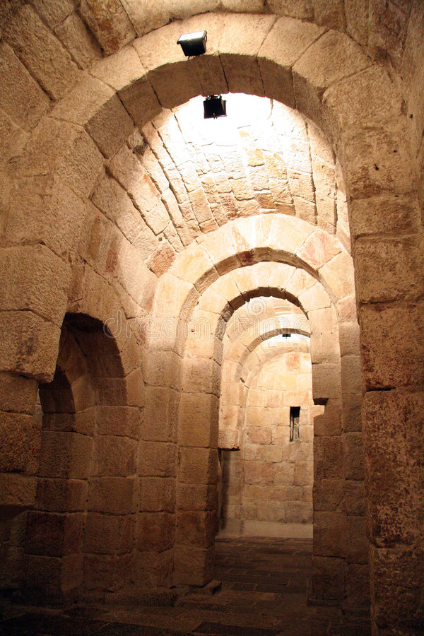 Tunel in a crypt. Bellow a church in monastery de Layre in Navarra, Spain royalty free stock photos