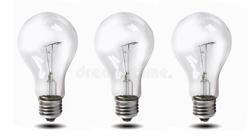 Tungsten lightbulb isolated over white background. Three tungsten light bulb on a white background stock photos