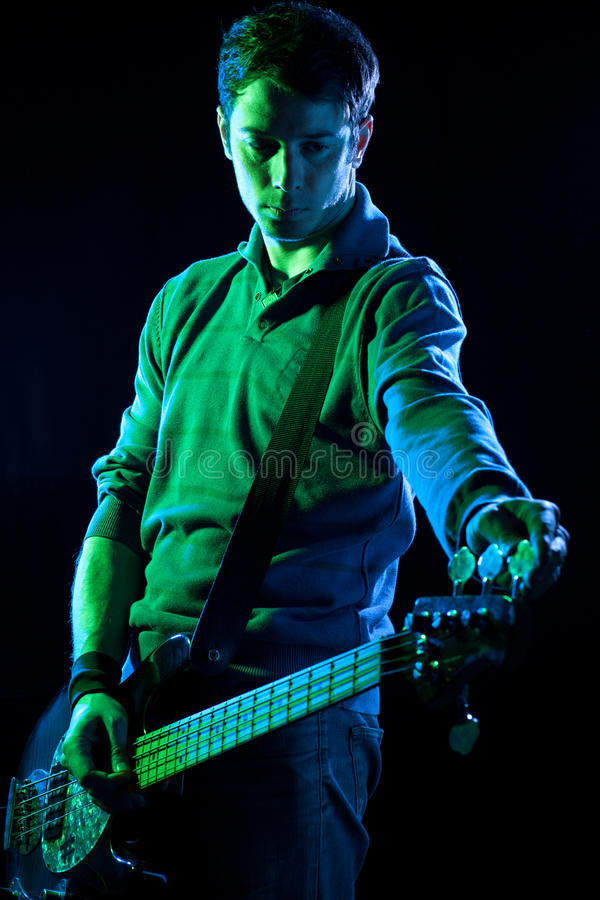 Download Tuning a Bass stock image. Image of bassist, wristband - 22927607