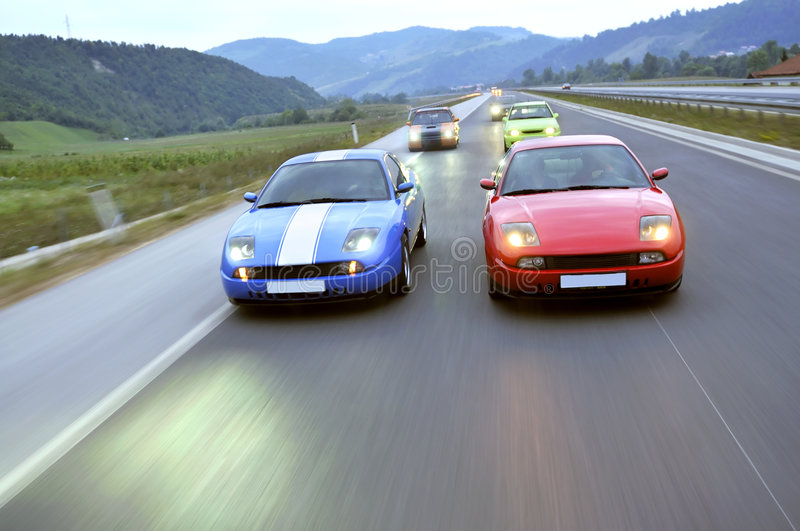 Tuning cars racing down the highway stock image