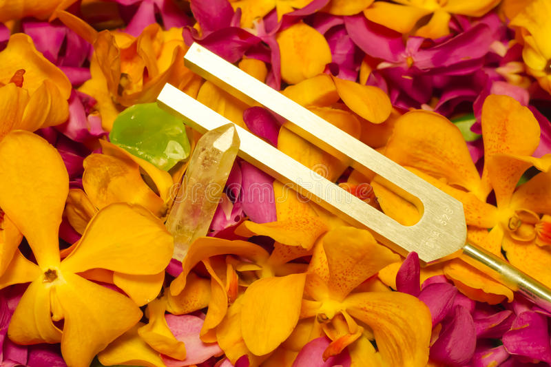 Tuning fork and crystal stone . stock photography