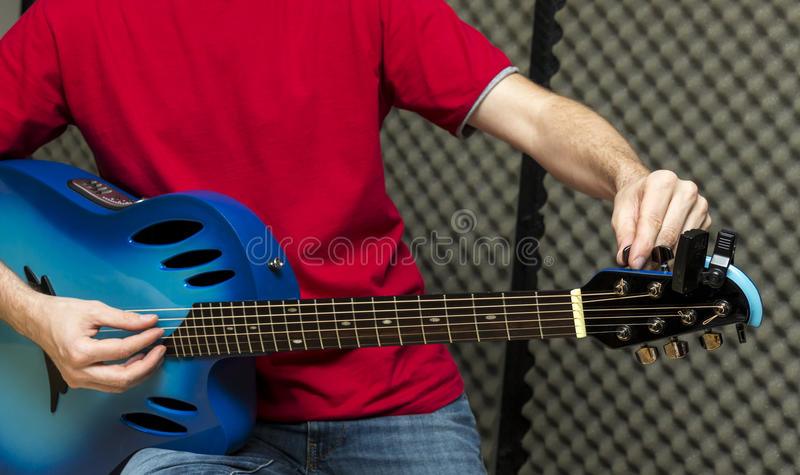 Tuning the guitar stock photos