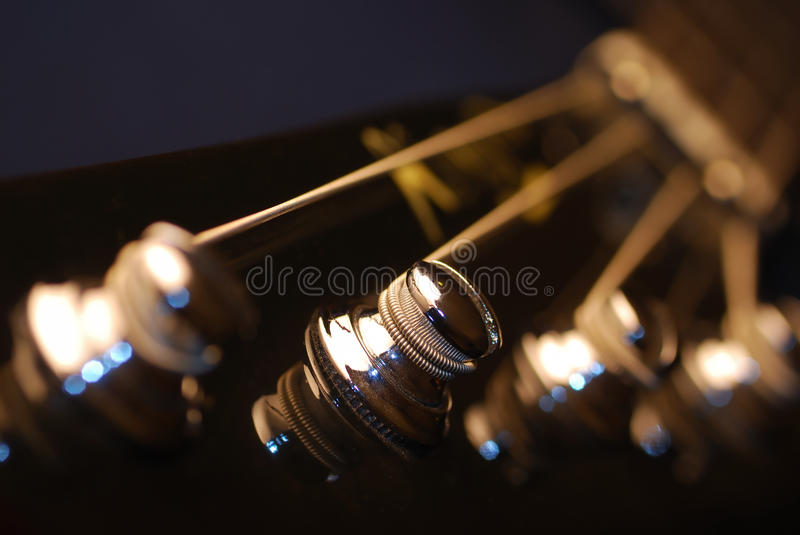 Tuning Pegs of A Bass Guitar royalty free stock photos