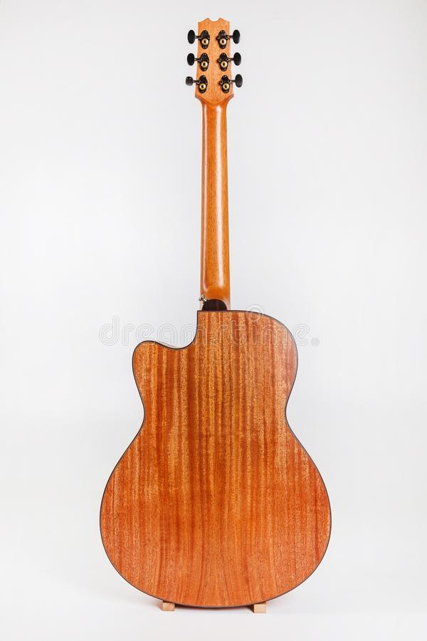 Tuning pegs on wooden machine head of six strings guitar on white background royalty free stock photo