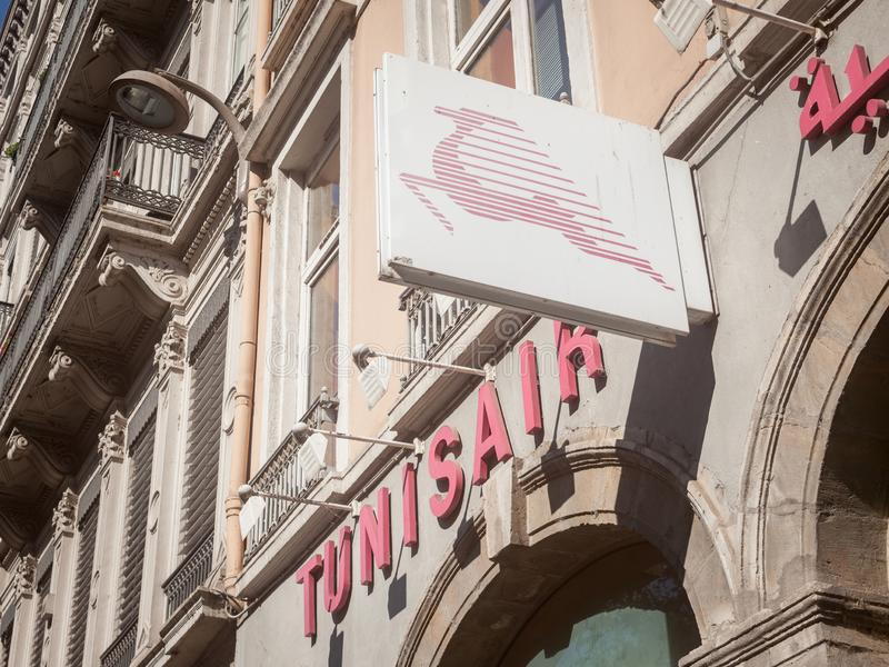 Tunisair logo in front of their boutique for Lyon. Tunisair is the main airline carrier from Tunisia stock image