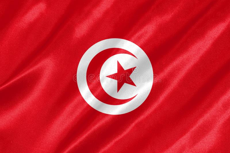Tunisia Flag. With waving on satin texture royalty free stock photo