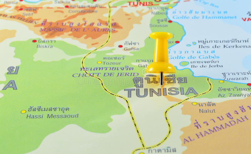 Tunisia in map. Macro shot of tunisia map with push pin royalty free stock image