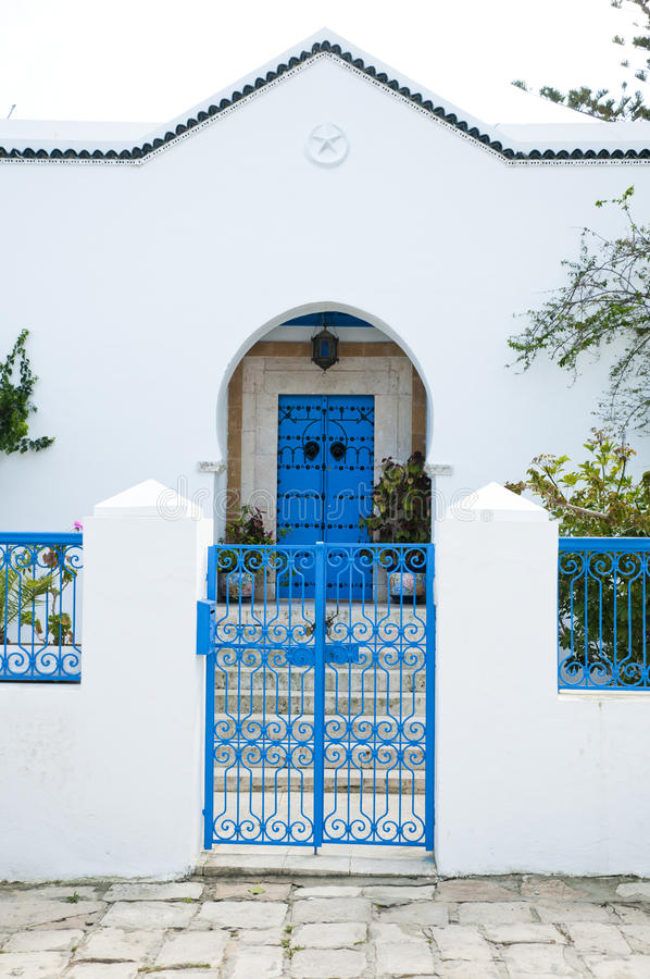 Tunisian House. Traditional Tunisian architecture white house with blue doors and windows stock photos