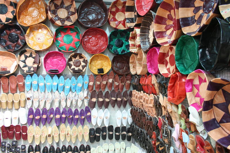 Tunisian Leather Souvenirs. Tunisian Souvenirs on display inside a shop in the streets of Tunis, capital of Tunisia: Colorful leather shoes and pillows royalty free stock photo