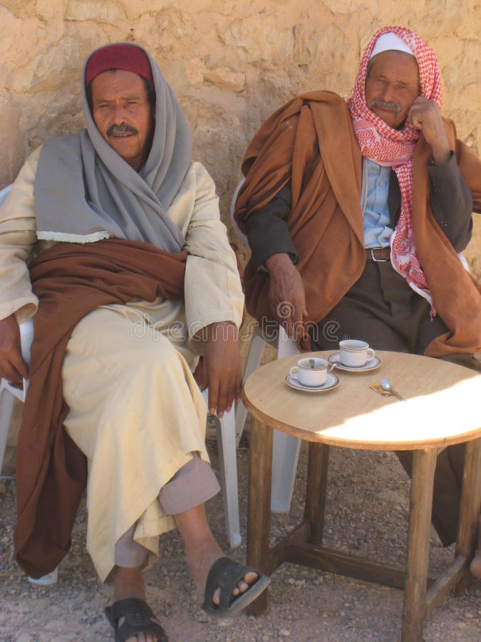 Tunisian men drinking coffee. Two tunisian men drinking coffee outdoors royalty free stock photo