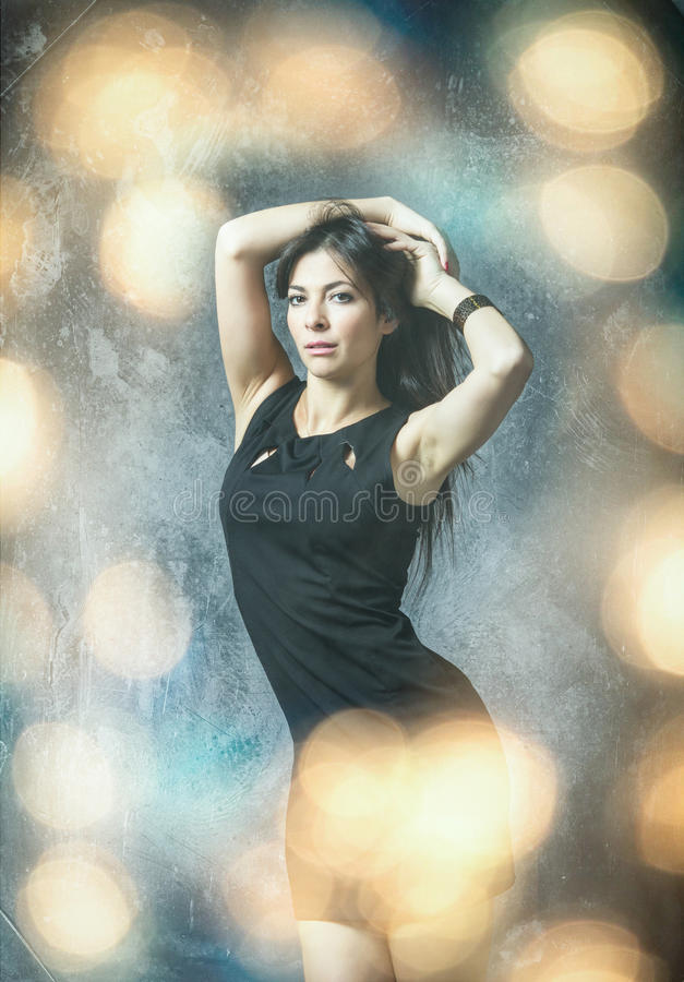 Tunisian model in gray background and bokeh royalty free stock image