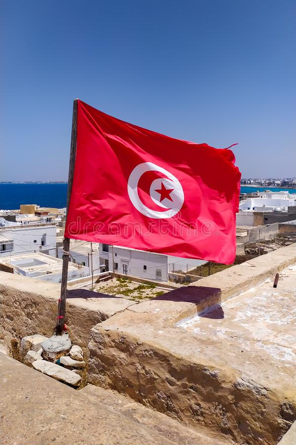 Tunisian national flag developing in the wind royalty free stock image