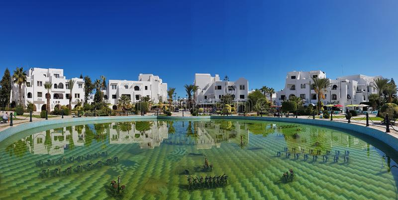 Tunisian resort town. A fountain is switched off in the middle of the Tunisian town stock photo