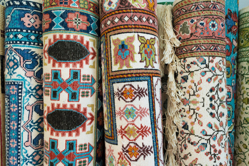 Tunisian Rugs. Rolled Up Tunisian Rugs on Sale stock photos