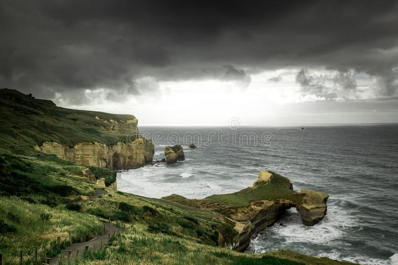 Tunnel beach view during cloudy weather, Dunedin, New Zealand. Tunnel beach view during cloudy weather, Dunedin, South Island, New Zealand stock photo