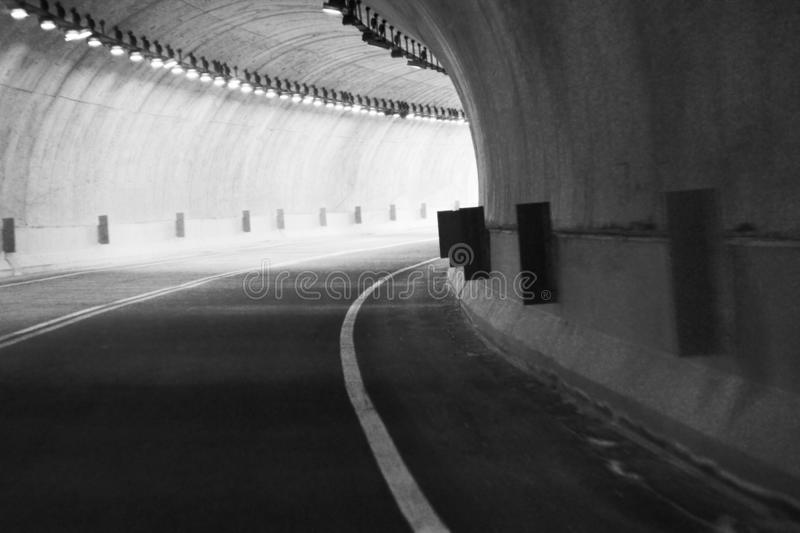The tunnel in black and white. This tunnel is one of the tunnels who brings you to the marble mountains stock image