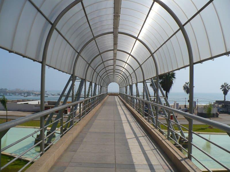 Tunnel-Bridge to beach stock photo