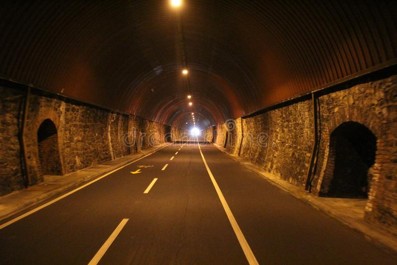 Tunnel in the city of San Remo, Italy. Road for cyclists.  royalty free stock photography
