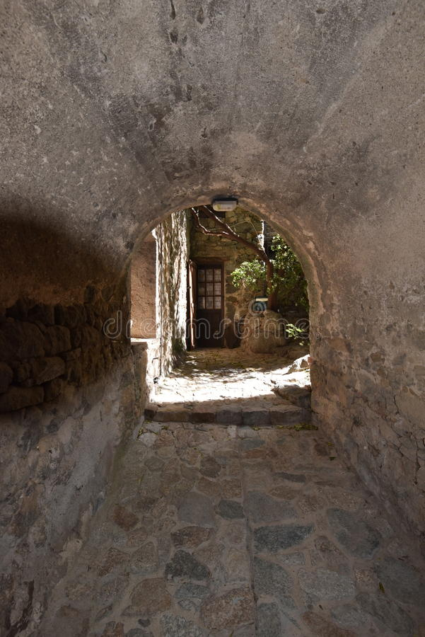 The tunnel in the Corsican village Sant`Antonino royalty free stock images