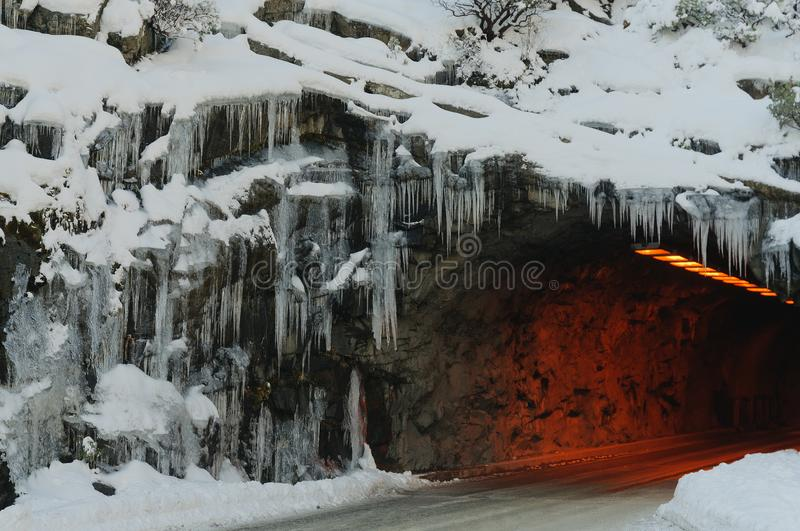 Tunnel entrance at Yosemite vista point. `Tunnel View` with icicles hanging in winter stock photography
