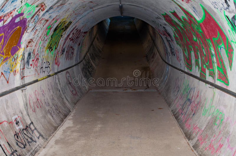 Tunnel With Graffiti royalty free stock images