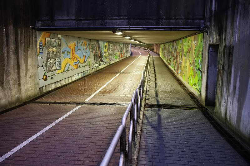 Tunnel with graffiti in bruges royalty free stock images