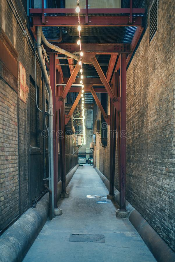 Tunnel with lanterns between two brick buildings in downtown of Chicago royalty free stock photo