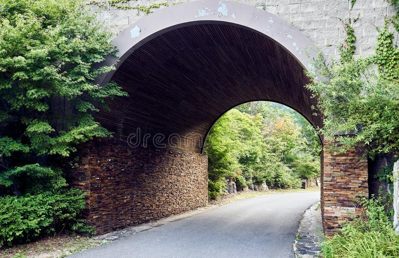 Tunnel made of bricks in the forest at Jechun, South Korea royalty free stock photo