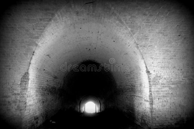 Tunnel to light stock photos