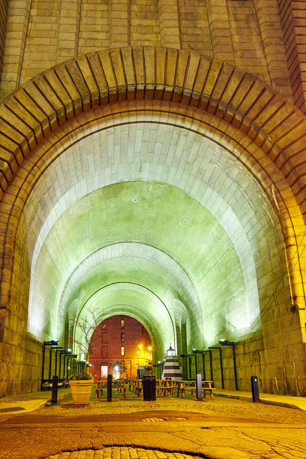 Tunnel under the Brooklyn bridge. In green and yellow light, NYC public space stock photos