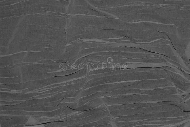 Tunt mörkt grått tyg vikt av vågor fotografering för bildbyråer