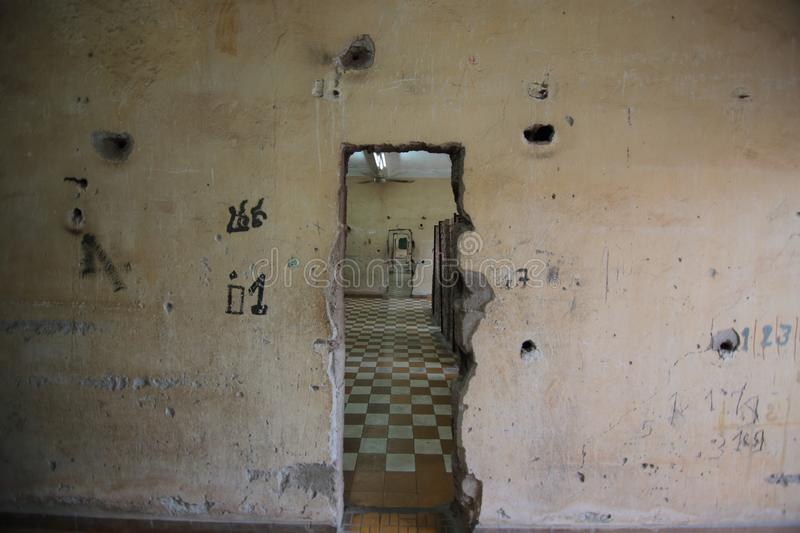 Wall inside Tuol Sleng Genocide Museum in Phnom Penh. An old wall with signs and holes, Tuol Sleng Genocide Museum, Phnom Penh, Cambodia royalty free stock photography