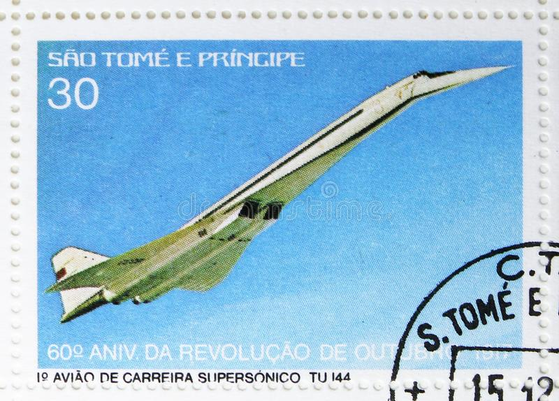 Tupolev Tu-144, 60th anniversary of the October Revolution serie, circa 1977. MOSCOW, RUSSIA - JULY 25, 2019: Postage stamp printed in Sao Tome and Principe stock photography