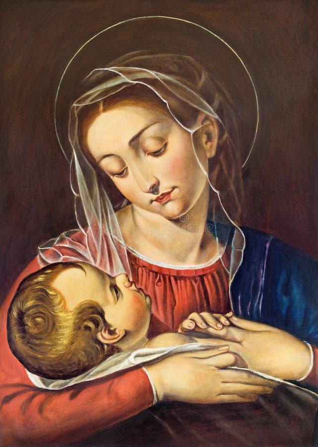 TURÍN, ITALIA - 15 DE MARZO DE 2017: La pintura de Madonna con el niño en la iglesia Chiesa di San Dalmazzo del artista desconoci fotografía de archivo