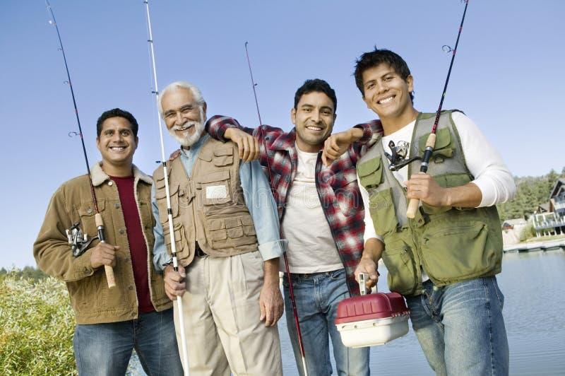 tur för sons tre för åldrig fiskeman medel arkivfoto