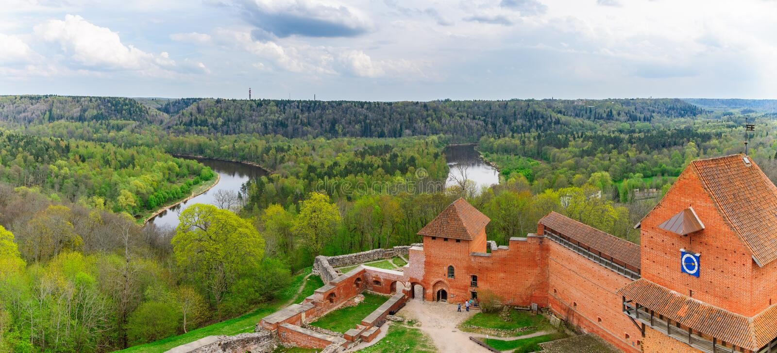 Turaida castle and Gauja river valley in Sigulda, Latvia. Bird view on Turaida castle and springtime Gauja river valley in Sigulda, Latvia stock photography