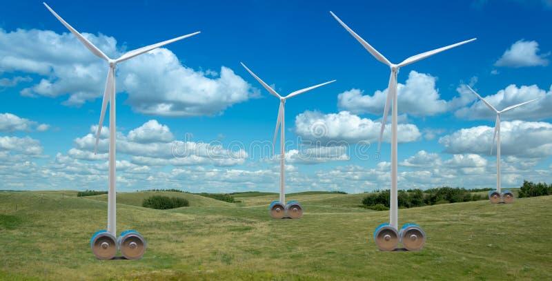 Turbinas de viento en campo hermoso con las baterías enormes imagen de archivo