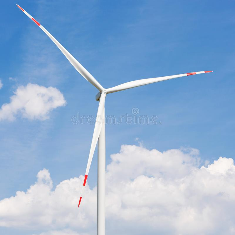 Turbine generator close up against the blue sky with clouds, big blades on the turbine royalty free stock photo