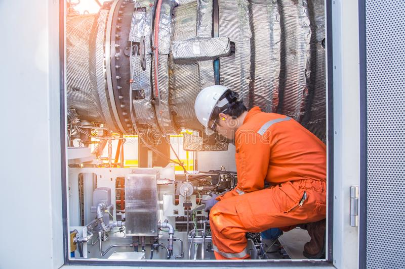 Turbine technician check and inspection gas turbine engine of electric power generator to cross check before startup. Turbine technician check and inspection royalty free stock photos