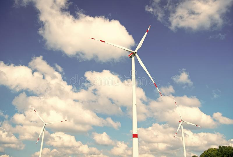 Turbine or windmill blue sky background. Alternative energy source. Go green eco friendly technology. Clean fuel energy. Source. Advantages and challenges of royalty free stock photography