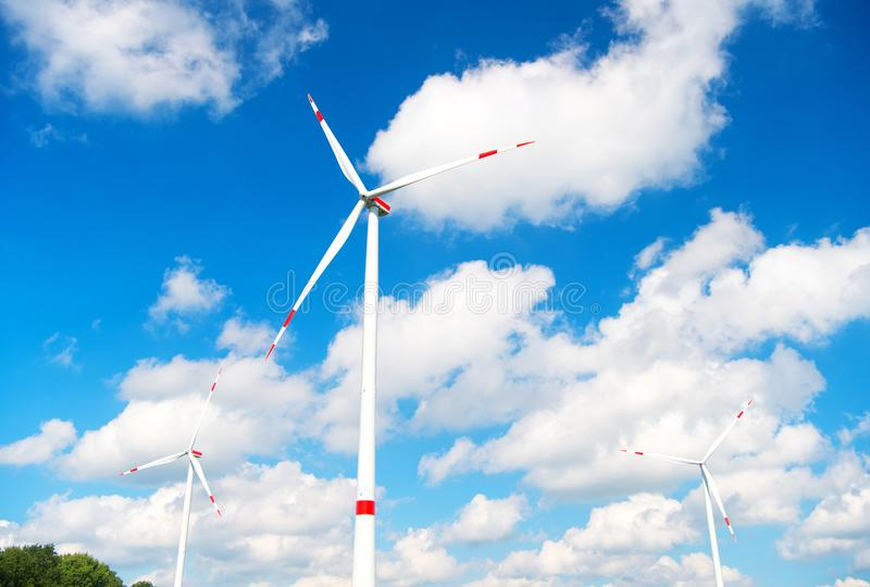 Turbine or windmill blue sky background. Alternative energy source. Go green eco friendly technology. Clean fuel energy. Source. Advantages and challenges of royalty free stock image