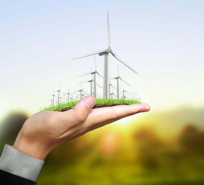 Turbines de vent dans la main image libre de droits