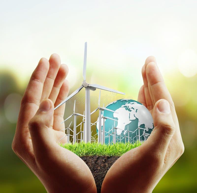 Turbines de vent dans la main images libres de droits